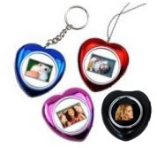 Esquire Heart Necklace Photo Frame Colour:Black Retail Box 3 Months warranty      Product Overview  The Esquire Mini heart shaped digital photo frame is able to store up 74 photo.  Simply upload your photos onto the device memory.  Long lasting